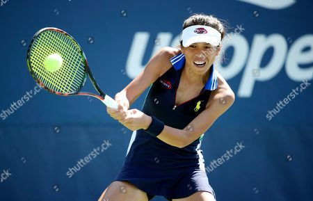 Su-Wei Hsieh, of Taiwan, returns a shot to Jana Cepelova, of Slovakia, during the first round of the US Open tennis tournament, in New York