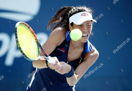 Stock Picture of Su-Wei Hsieh, of Taiwan, returns a shot to Jana Cepelova, of Slovakia, during the first round of the US Open tennis tournament, in New York