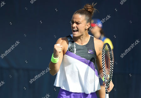 Maria Sakkari, of Greece, reacts after a shot to Camila Giorgi, of Italy, during the first round of the US Open tennis tournament, in New York