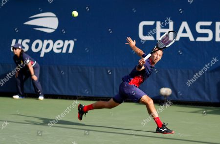 Philipp Kohlschreiber, of Germany, returns a shot to Lucas Pouille, of France, during the first round of the US Open tennis tournament, in New York