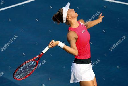 Viktorija Golubic, of Switzerland, serves to Zhang Shuai, of China, during the first round of the US Open tennis tournament, in New York