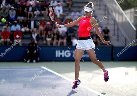 Viktorija Golubic, of Switzerland, returns a shot to Zhang Shuai, of China, during the first round of the US Open tennis tournament, in New York