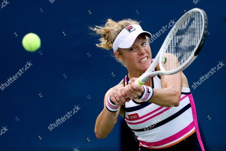 Laura Siegemund, of Germany, returns a shot to Magdalena Frech, of Poland, during the first round of the US Open tennis tournament, in New York