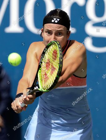 Anastasija Sevastova, of Latvia, returns a shot to Eugenie Bouchard, of Canada, during the first round of the US Open tennis tournament, in New York