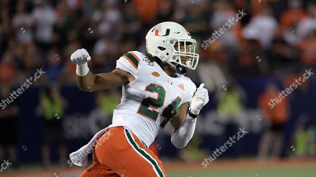 Miami cornerback Christian Williams (24) defends during the first half of an NCAA college football game against Florida, in Orlando, Fla
