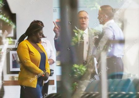 Althia Meggie, David Frankel, Jorge Carballo. This photo shows Althia Meggie, left, and Jorge Carballo, right, with defense attorney David Frankel, center, inside of the Broward County Jail lobby in Fort Lauderdale, Fla., before Meggie is being charged with aggravated manslaughter and evidence tampering, and Carballo being charged with multiple counts of aggravated manslaughter. Hollywood police on Tuesday will announce their evidence for the manslaughter charges filed against Carballo, administrator, Meggie, nurse and Sergo Colin, nursing supervisor for the 2017 heat-related deaths of 12 patients after Hurricane Irma knocked out the facility's air conditioning