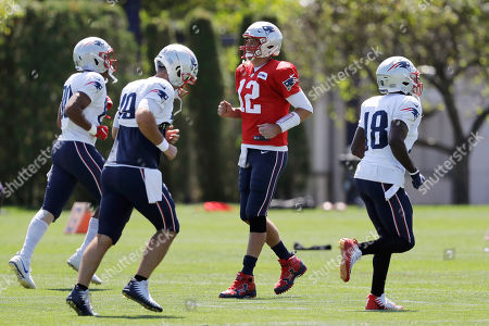 Stock Photo of Stephen Anderson, Joe Cardona, Tom Brady, Matthew Slater, Julian Edelman, Devin Lucien, Danny Amendola. New England Patriots quarterback Tom Brady, center right, smiles while warming up with teammates, from left, tight end Stephen Anderson, long snapper Joe Cardona, and wide receiver Matthew Slater during an NFL football practice, in Foxborough, Mass