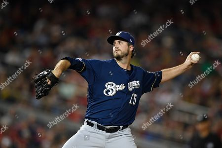 Milwaukee Brewers starting pitcher Drew Pomeranz delivers a pitch during a baseball game against the Washington Nationals, in Washington