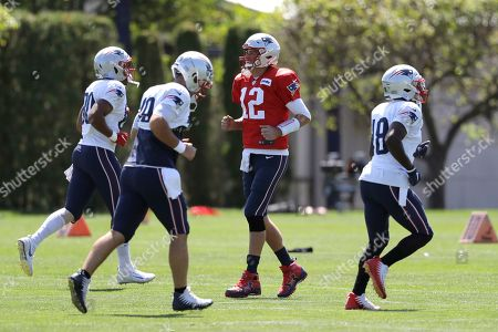 Julian Edelman,Devin Lucien,Danny Amendola. New England Patriots quarterback Tom Brady, center right, smiles while warming up with teammates, from the left, tight end Stephen Anderson, long snapper Joe Cardona, and wide receiver Matthew Slater during an NFL football practice, in Foxborough, Mass