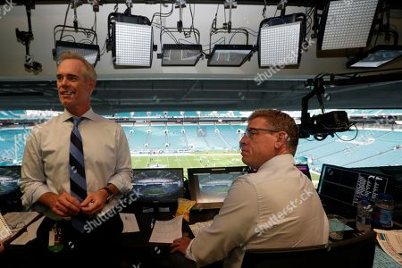 Joe Buck, Troy Aikman. Fox Sports play-by-play announcer Joe Buck, left, and analyst Troy Aikman, right, work in the broadcast booth before a preseason NFL football game between the Miami Dolphins and Jacksonville Jaguars, in Miami Gardens, Fla. The exhibition game served as a dress rehearsal for the Fox Sports crew for the upcoming Super Bowl to be hosted by Miami in 2020