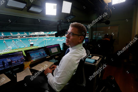 Fox Sports analyst Troy Aikman works in the broadcast booth before a preseason NFL football game between the Miami Dolphins and Jacksonville Jaguars, in Miami Gardens, Fla. The exhibition game served as a dress rehearsal for the Fox Sports crew for the upcoming Super Bowl to be hosted by Miami in 2020