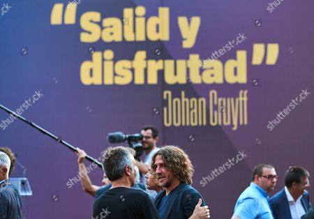 FC Barcelona's former player Carles Puyol attends the inauguration of a statue dedicated to Dutch soccer legend Johan Cruyff next to Camp Nou stadium in Barcelona, Catalonia, Spain, 26 August 2019. FC Barcelona opened a statue next to Camp Nou stadium and the Estadi Johan Cruyff stadium at Joan Gamper Sports City as tribute by the FC Barcelona's soccer legend Johan Cruyff.