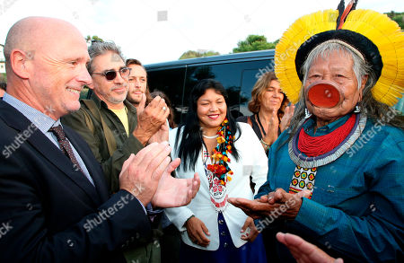 Kayapo tribal leader Raoni Metuktire is applauded by Emmanuel Alzuri the mayor of Bidart in southwestern France, as he arrives for a press conference on . Raoni, the figurehead of the fight against deforestation in the Amazon, said that he met French President Emmanuel Macron on Monday evening after the G-7 summit ended in nearby Biarritz