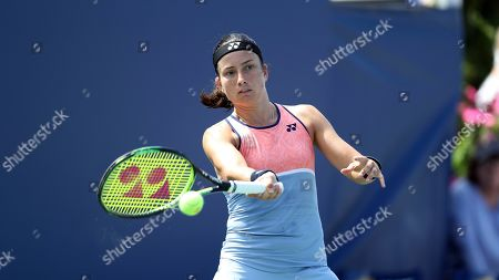 Anastasija Sevastova, of Latvia, returns a shot from Eugenie Bouchard, of Canada, during the first round of the US Open tennis tournament, in New York