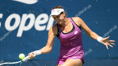 Jana Cepelova, of Slovakia, returns a shot to Su-Wei Hsieh, of Taiwan, during the first round of the US Open tennis tournament, in New York