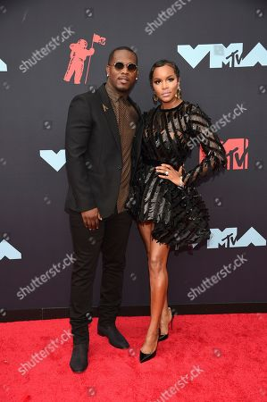 Stock Photo of Tommicus Walker, LeToya Luckett. Tommicus Walker, left, and LeToya Luckett arrive at the MTV Video Music Awards at the Prudential Center, in Newark, N.J