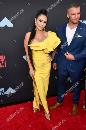 Jenni Farley, left, also known as JWoww, and Zack Clayton Carpinello arrive at the MTV Video Music Awards at the Prudential Center, in Newark, N.J