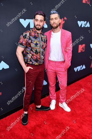 Michael Turchin, left, and Lance Bass arrive at the MTV Video Music Awards at the Prudential Center, in Newark, N.J