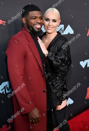 P. K. Subban, left, and Lindsey Vonn arrive at the MTV Video Music Awards at the Prudential Center, in Newark, N.J