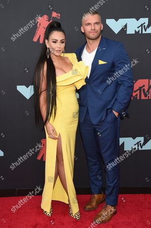 "Jenni J-Woww Farley, Zack Clayton Carpinello. Jenni "" Jenni J-Woww Farley "" Farley, left, and Zack Clayton Carpinello arrive at the MTV Video Music Awards at the Prudential Center, in Newark, N.J"