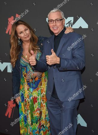 Dr. Dr Drew Pinsky, Susan Pinsky. Dr. Dr Drew Pinsky, right, and Susan Pinsky arrive at the MTV Video Music Awards at the Prudential Center, in Newark, N.J