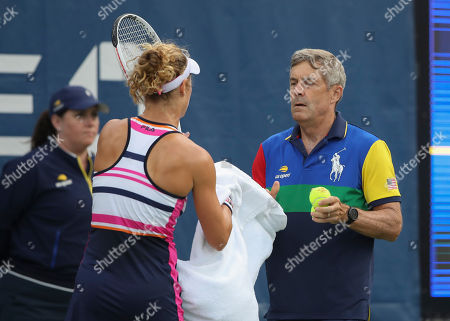 Laura Siegemund accepts a towel from an older ball boy