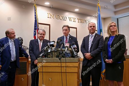 Stock Image of Mike Hunter, center, Oklahoma Attorney General answers a question during a news conference following the announcement of the Opioid Lawsuit decision in Norman, Okla., . Pictured from left are attorneys Reggie Whitten, Michael Burrage, Hunter, attorney Brad Beckworth and Terri White, Commissioner, Oklahoma Department of Mental Health and Substance Abuse Services
