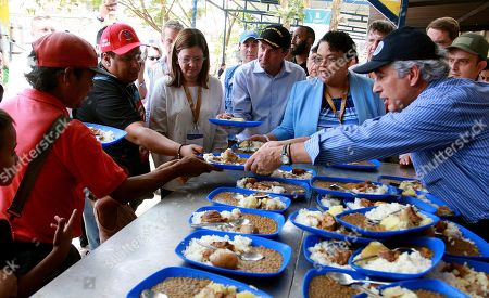 US Secretary of Health and Human Services Alex Azar (4-L), Haitian Minister of Health Marie Greta Roy Clement (2-R) and Colombian Minister of Health Juan Pablo Uribe (R) hand food to Venezuelans in the Divine Providence dining room, in Cucuta, Colombia, 26 August 2019. The governments of ten countries in Latin America are meeting in Colombia to seek a regional response in health for Venezuelan migrants, where they stressed the importance of coordinated work to face the crisis that Venezuelans are facing.