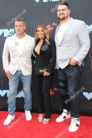 Tom Murro (L), US actor Dolores Catania (C) and American football player Brent Qvale (R) arrive on the red carpet for the 2019 MTV Video Music Awards at Prudential Center in Newark, New Jersey, USA, 26 August 2019