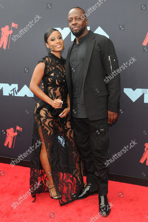 US musical artist Jazzy Amra (L) and Haitian rapper Wyclef Jean (R) arrive on the red carpet for the 2019 MTV Video Music Awards at Prudential Center in Newark, New Jersey, USA, 26 August 2019