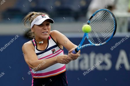 Sofia Kenin returns a shot to CoCo Vandeweghe during the first round of the U.S. Open tennis tournament, in New York