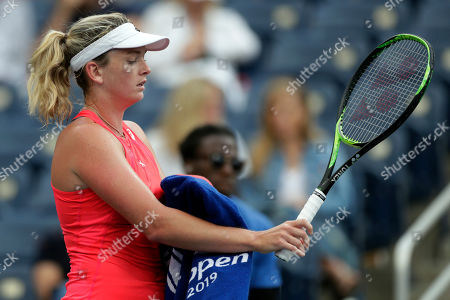 CoCo Vandeweghe reacts after losing a game against Sofia Kenin during the first round of the U.S. Open tennis tournament, in New York