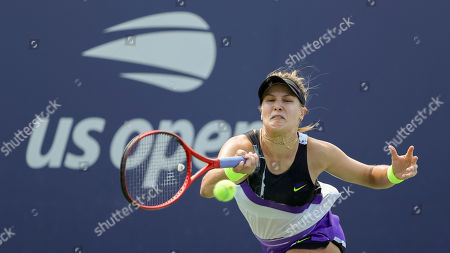 Eugenie Bouchard, of Canada, returns a shot to Anastasija Sevastova, of Latvia, during the first round of the US Open tennis tournament, in New York