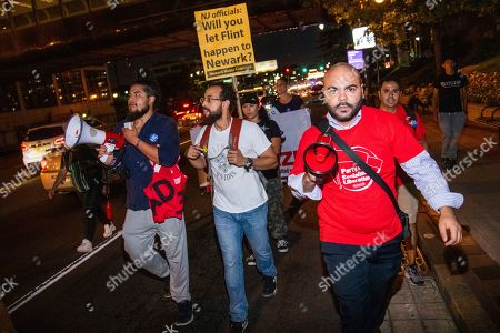 Protestors march outside the MTV Video Music Awards in response to lead contamination in Newark's drinking water,, in Newark, N.J