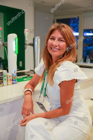 Genevieve Gorder hangs out in the Heineken suite during opening night