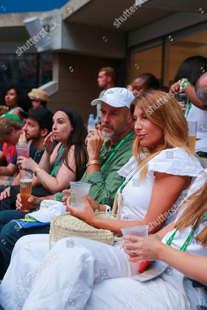 Genevieve Gorder and her husband Christian Dunbar hang out in the Heineken suite during opening night