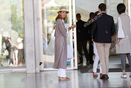 Princess Elena de Borbon (C), older daughter of Spain's emeritus King Juan Carlos I (unseen), arrives at Hospital Quiron Salud Madrid, to visit her father, in the town of Pozuelo de Alarcon, outside Madrid, Spain, 27 August 2019. The monarch recovers in the hospital from a triple bypass surgery last 24 August.