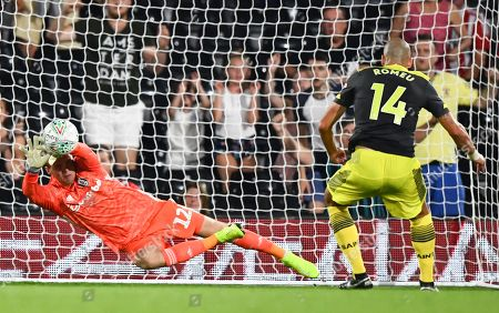 Goalkeeper Marek Rodak of Fulham makes a point blank save from Oriol Romeu of Southampton