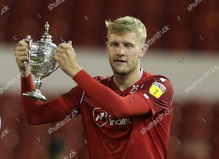 Nottingham Forest's Joe Worrall holds aloft the Brian Clough trophy