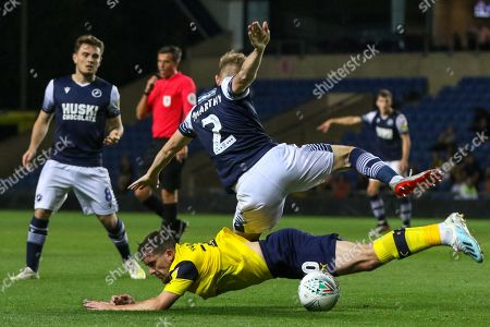 27th August 2019 , Kassam Stadium, Oxford, England; Carabao Cup Football, Second Round, Oxford United vs Millwall  ;Jason McCarthy (02) of Millwall slides in on Jamie Hanson of (20) Oxford Credit: Matt O?Connor/News Images English Football League images are subject to DataCo Licence