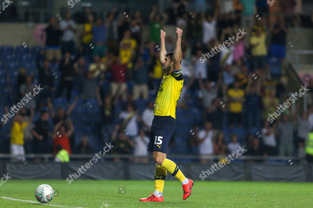 27th August 2019 , Kassam Stadium, Oxford, England; Carabao Cup Football, Second Round, Oxford United vs Millwall  ;John Mousinho (15) of Oxford celebrates his goal to make it 4-2 on penalties  Credit: Matt O?Connor/News Images English Football League images are subject to DataCo Licence