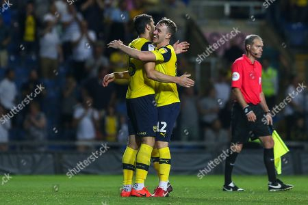 27th August 2019 , Kassam Stadium, Oxford, England; Carabao Cup Football, Second Round, Oxford United vs Millwall  ;John Mousinho (15) of Oxford celebrates with team mate Sam Long (12) of Oxford Credit: Matt O?Connor/News Images English Football League images are subject to DataCo Licence