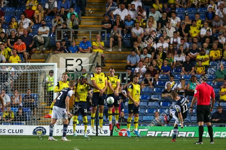 27th August 2019 , Kassam Stadium, Oxford, England; Carabao Cup Football, Second Round, Oxford United vs Millwall  ; Shane Ferguson (11) of Millwall takes a free kick  Credit: Matt O?Connor/News Images English Football League images are subject to DataCo Licence