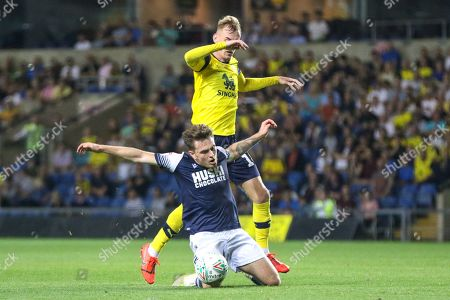 27th August 2019 , Kassam Stadium, Oxford, England; Carabao Cup Football, Second Round, Oxford United vs Millwall  ;Ben Thompson (08) of Millwall is fouled by Mark Sykes (18) of Oxford  Credit: Matt O?Connor/News Images English Football League images are subject to DataCo Licence