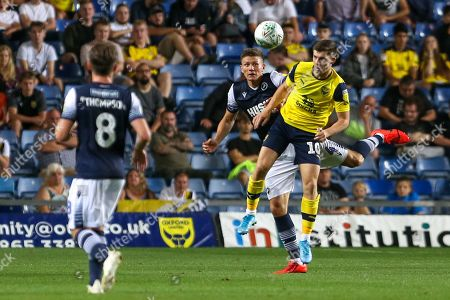 27th August 2019 , Kassam Stadium, Oxford, England; Carabao Cup Football, Second Round, Oxford United vs Millwall  ;Ben Woodburn (10) of Oxford jumps up to win the high ball  Credit: Matt O?Connor/News Images English Football League images are subject to DataCo Licence