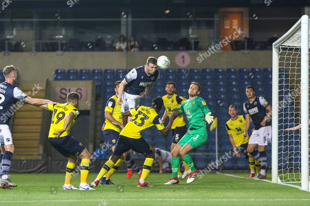 27th August 2019 , Kassam Stadium, Oxford, England; Carabao Cup Football, Second Round, Oxford United vs Millwall  ;Jon Daoi Boovarsson (23) of Millwall heads on goal Credit: Matt O?Connor/News Images English Football League images are subject to DataCo Licence