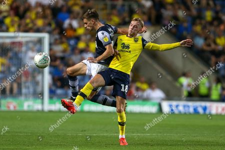 27th August 2019 , Kassam Stadium, Oxford, England; Carabao Cup Football, Second Round, Oxford United vs Millwall  ;Mark Sykes (18) of Oxford pressures Jayson Molumby (16) of Millwall for the ball Credit: Matt O?Connor/News Images English Football League images are subject to DataCo Licence