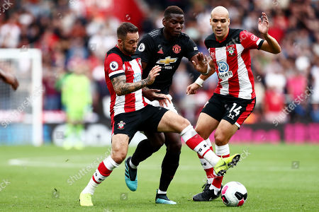 Paul Pogba of Manchester United is blocked by Danny Ings and Oriol Romeu of Southampton.