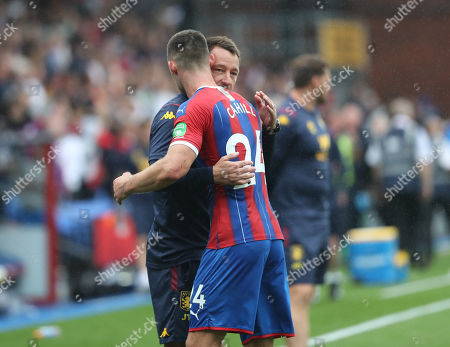 Former Chelsea centre back partnership John Terry, an Aston Villa coach and Gary Cahill of Crystal Palace greet each other at fulltime