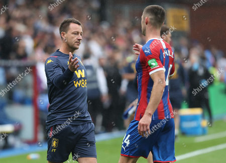 Stock Photo of Former Chelsea centre back partnership John Terry, an Aston Villa coach and Gary Cahill of Crystal Palace greet each other at fulltime